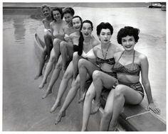 Photograph of showgirls posing by Dunes Hotel swimming pool, Las Vegas, 1955