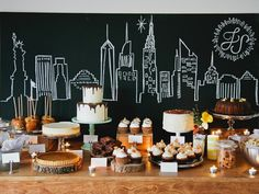 Great wedding buffet idea! Blackboard and chalk backdrop of NYC