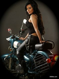 Royal Enfield Biker Girl. Hell yeah....she is smokin hot!!