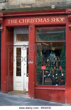the frontage of one of edinburghs all year round christmas shops stock - The Christmas Shop
