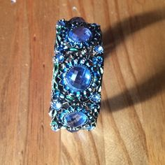 Blue Floral Cuff Boho Bracelet Bronze color bracelet with filigree detail and diamanté stones. Open cuff. Main colors are bronze & blue. Perfect festival bracelet. One size/Adjustable. Please ask if you have questions. Boutique Jewelry Bracelets