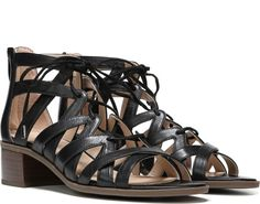Feel the breeze of a seaside stroll in this feminine lace-up sandal. Leather upper. Open toe, back zip closure. Crisscrossing strap detailing. 2 and 1/2 inch stacked block heel.
