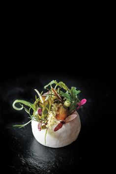 """Salad - Served at the end of the savory portion of the tasting menu at Atelier Crenn, this """"salad,"""" a vinegar meringue dressed with greens (instead of the other way around) is """"a bit disorienting,"""" writes Crenn."""