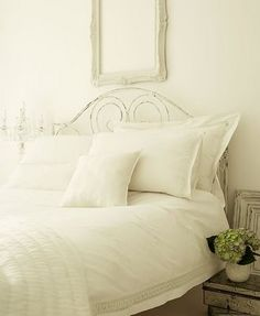 Flowers really pop in an all-white bedroom
