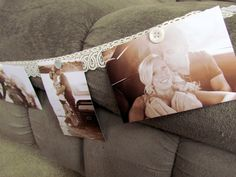 wedding photo garland : custom shabby chic bridal shower decor with lace and vintage buttons. $35.00, via Etsy.