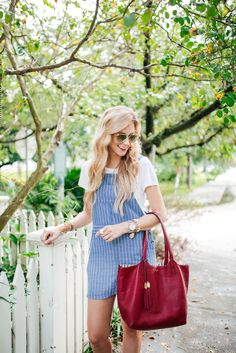A Pinch of Lovely. White t-shirt+blue striped dress overall+nude mules+red…