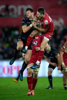 Scarlets fullback Liam Williams (r) and Dan Biggar of the Ospreys compete for a high ball during the Guinness Pro 12 match between Ospreys and Scarlets at Liberty Stadium on December 27, 2016 in Swansea, United Kingdom.
