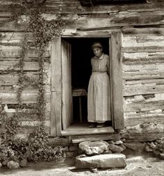 July 1939. Caroline Atwater standing in the kitchen door of her log house. Orange County, North Carolina
