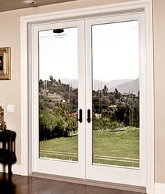 8 sliding glass patio doors love the offset grille pattern milgard fibreglass patio doors in calgary planetlyrics Gallery