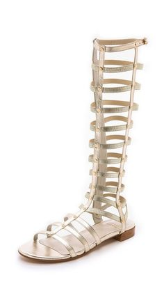 Gladiator Sandals - Cava Tonal elastic straps lend a comfortable, contoured fit to these sexy knee high gladiator sandals. Soft metallic leather bands offer easy structure, and a buckle strap adjusts the top. Exposed zip closure. Leather sole. Leather: Goatskin. Made in Spain. Th Trovato su Styletorch