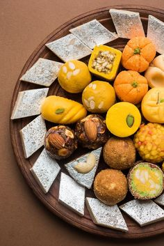 Stock photo of Indian sweets served in silver or wooden plate. variety of Peda, burfi, laddu in decorative plate, selective focus Indian Food Menu, Indian Dessert Recipes, Indian Sweets, Indian Foods, Party Food Platters, Food Dishes, Sweets Photography, Diwali Photography, Indian Cheese