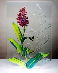 Clever use of painting and kiln carving on same piece.