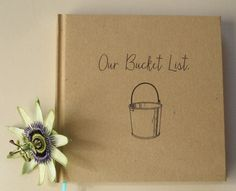 THE ORIGINAL: Our Bucket List Journal. The ideal gift for your first wedding anniversary. Hand crafted, unique and spunky wedding anniversary gift. Anniversary book. #Couplebucketlist