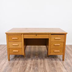 This retro tanker desk is featured in a solid wood with a rustic light maple finish. This large desk is in great condition with 7 drawers, a large table top and 1 pull out writing shelf (1 is missing). Perfect for working on big projects!   #retro #desks #tankerdesk #sandiegovintage #vintagefurniture