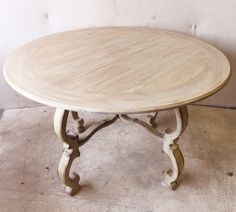Round Warm White Dining Table with Ornately Carved Legs $350