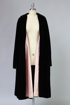 Very rare 1950s velvet opera coat featuring a beautiful blush pink satin lining. This coat celebrates and perfectly compliments the full and