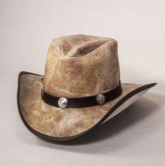 The Limited Edition Faultline leather cowboy hat is as classically western as it gets. They are high-quality, top-grain cowhide, and finished so they show the texture and subtleties of the cowhide while maintaining visible pull-up, which means that the hats get more characterized as you handle them. Complemented by a matching buffalo nickel band, these hats are great additions to any cowboys' or cowgirls' wardrobe.  #hats #cowboyhats #cowgirlhats Leather Cowboy Hats, Cowgirl Hats, Western Hats, Hat Hooks, Hat Making, Cowgirls, Cowboys, Fossil, Buffalo