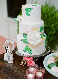 pink and green wedding cakes - photo by Sarah Maren Photography http://ruffledblog.com/spring-blooms-wedding-inspiration