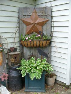 Old door with hanging basket in the garden