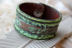 Hand Painted Distressed Vintage Hand Tooled Leather Cuff- Rustic- Green- Brown-  Reclaimed- Upcycled- OOAK. $40.00, via Etsy.