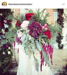 Darling Bouquet filled with curly pine, hanging amaranthus, cedar,cypres,pine, dusty miller, garden roses, carnations, hydrangeas, spray roses, & seeded eucalyptus