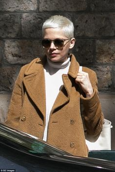 Michelle Williams looks effortlessly chic in a wool tan coat in Paris #dailymail