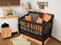 Orange Crib Bedding With Grey And Brown Black Accents In A Rustic Nursery