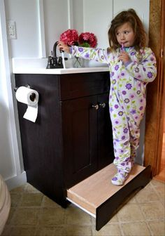 Great solution to an everyday problem by installing a hideaway stool like a drawer under a sink in a bathroom