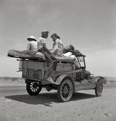 """May 1937. """"Migratory family traveling across the desert in search of work in cotton at Roswell, New Mexico. U.S. Route 70, Arizona.""""  Dorothea Lange / Resettlement Administration photo."""
