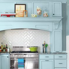 Design Your Backsplash!  Use a herringbone pattern to show off white or neutral tiles.  Photo: Julian Wass   thisoldhouse.com   from All About Ceramic Subway Tile