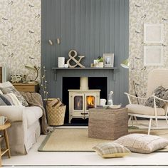 I've never been a fan of wood burning stoves but this is kinda cute! Romantic living room with amazing wallpaper via Mix and Chic.