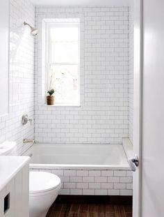 Dark shower grout, white subway tile b a t h r o o m s white bathroom tiles White Subway Tile Bathroom, Laundry In Bathroom, Master Bathroom, Subway Tiles, White Tiles, Grey Tiles, Bathroom Tiling, Bathroom Gray, Tub Tile