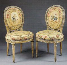 A pair of Louis XVI painted and parcel-gilt chaises en cabriolet, last quarter 18th century, upholstered in contemporary tapestry.