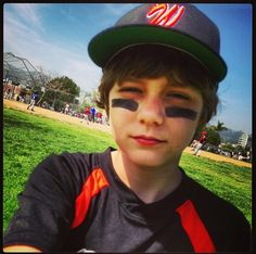 Ty Simpkins doing one of his favourite hobbies: Playing Baseball