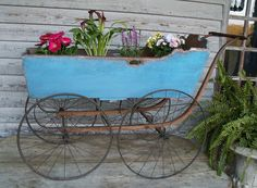 The wagon box started life as part of a18th century wooden cradle. The four original Spoke Wheels are from the 1800's and are beautiful. The upper edge of the back and sides are beautifully shaped.   eBay!