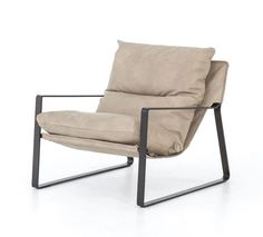 """Sling-style seating of light leather sits low and curved for a fresh take on a throwback form with a slim, gunmetal-finished iron framing Colors:Gunmetal, Umber NaturalMaterials:Iron, Top Grain Leather Size:Overall Dimensions:29.00""""w x 36.00""""d x 29.00""""hSeat Depth:20""""Seat Height:19""""Arm Height from Floor:20""""Arm H"""