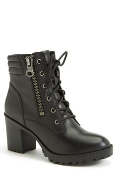 Wearing these moto boots with jeans and and an oversized cardigan.