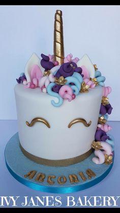 Unicorn cake with curley fondant mane.