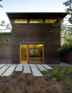 Concrete slabs are very effective, draws the eye to the house.