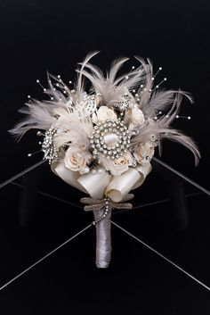 pretty brooch, flowers, and feathers