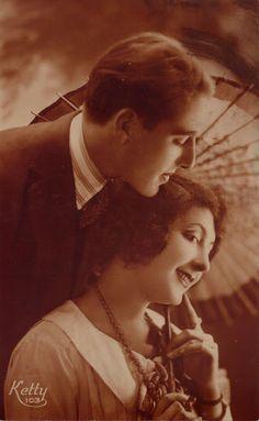 1920s couple. Vintage romance postcard.