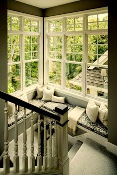 Windows in stairwell with reading nook