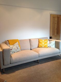 Cushions: Orla Kiely, Sunflower & Cole & Son floral and bird fabric made by hand. Sofa: Ikea NOCKEBY, Tenö light grey, Chrome plated legs.