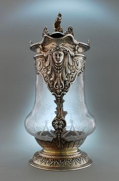 The spout is thought to represent Pocahontas after an American print of 1870, which is in the Library of Congress.