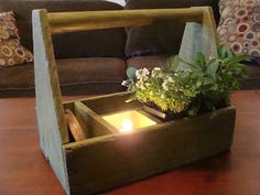Old wooden tool box gets new life as table centerpiece. Love it!