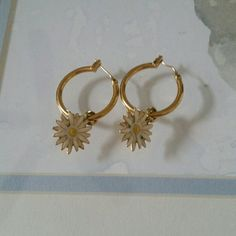 Daisy earrings Kate Spade mini hoop daisy earrings. All jewelry is buy one get one FREE (of equal or lesser value). Just leave a note in the comment section for your choice of free item. Jewelry Earrings