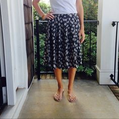 Black and white floral skirt In excellent condition. I don't think this skirt has ever been worn. It's black with white flowers and white polka dots. The back half of the waistband is elastic. Looks cute with a tank tucked in too. 100% polyester. Thanks for looking. Xhilaration Skirts