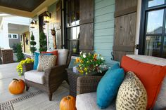 seating area by front entry with area rug and decorative pillows