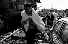 The consequences of the earthquake and Tsunami which hit Japan on March 11,2011. The magnitude of the earthquake was 9.0 on the Richter scale. the city of Ishinomaki was severely affected by the tsunami. Some of the survivors go back to take anything that can be used.  COPYRIGHT:Gianni Giosue