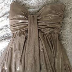 Cache Gold dress Worn once, small pull but not noticeable when worn. Reason for reduced price. EUC. Doesn't fit me, so I can't model. Cache Dresses Strapless